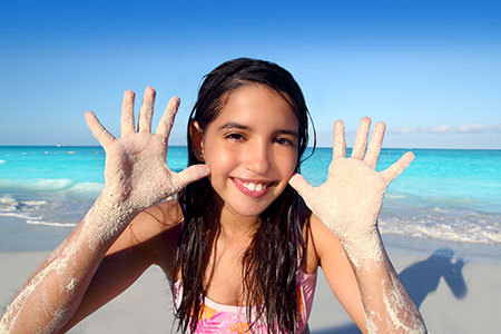 Girl with Sand on Hands - Pediatric Dentist in Houston, TX